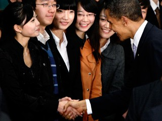 PHOTO U.S. President Barack Obama shakes hands with student Wang Zifei,