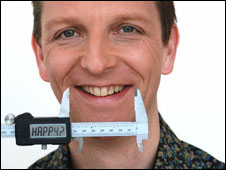 BBC journalist Mark Easton having his smile measured